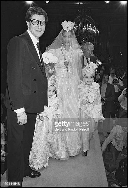 Yves Saint Laurent With A Model Wearing Wedding Dress During The Presentation Of His Fall