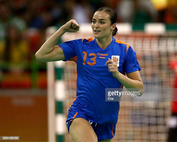 Yvette Broch of Netherlands celebrates her goal in the first half against Russia on Day 9 of the Rio 2016 Olympic Games at the Future Arena on August...