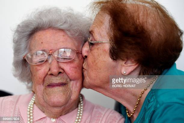 TOPSHOT Yvette Florens 85 years old kisses her mother French eldest person Honorine Rondello 113 years old on September 7 2016 at the retirement home...