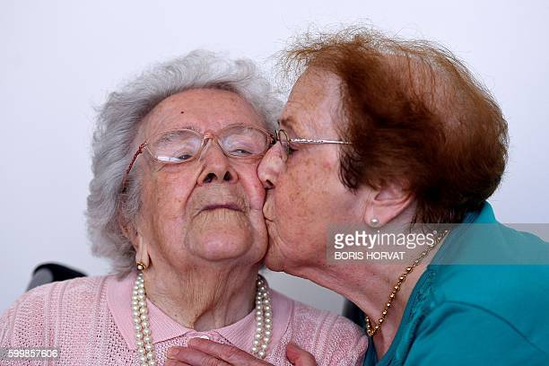 Yvette Florens , 85 years old kisses her mother French eldest person Honorine Rondello , 113 years old, on September 7, 2016 at the retirement home...
