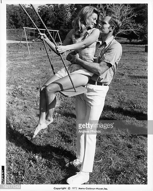 Yvette Mimieux is held on swing by Charlton Heston in a scene from the film 'Skyjacked' 1972