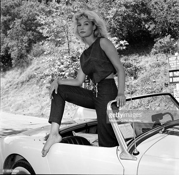 Yvette Mimieux poses for a portrait with a car in Los AngelesCA