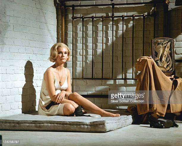 Yvette Mimieux US actress sitting on a mattress in a prison cell in a publicity still issued for the film 'Jackson County Jail' USA 1976 The drama...