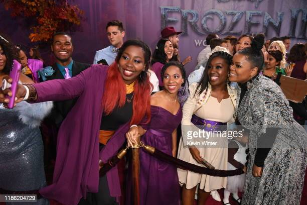 """Yvette Nicole Brown poses with fans during the premiere of Disney's """"Frozen 2"""" at Dolby Theatre on November 07, 2019 in Hollywood, California."""