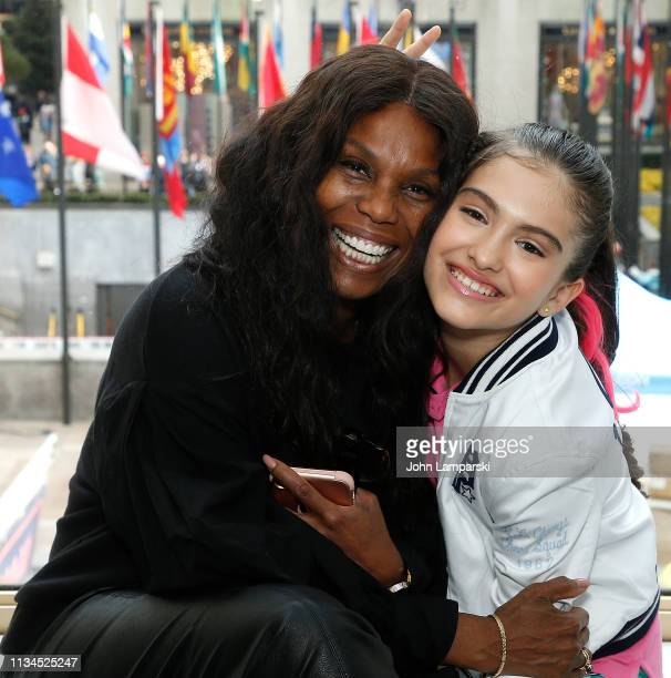 Yvette NoelSchure poses wirh Rita Angel Taylor as CARE and Artist Rita Angel Taylor present Activation For International Women's Day at FAO Schwarz...