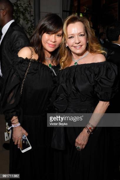 Yvette Yung and Caroline Scheufele amfAR Paris Dinner 2018 at The Peninsula Hotel on July 4 2018 in Paris France