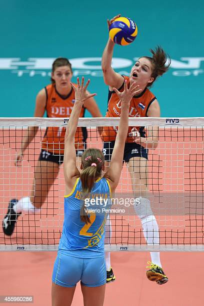 Yvon Belien of Netherlands smashes as Lyudmila Issayeva of Kazakhstan blocks during the FIVB Women's World Championship pool C match between...