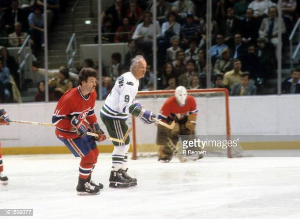 Yvon Lambert of the Montreal Canadiens and Gordie Howe of the Hartford Whalers skate on the ice during Game 3 of the 1980 Preliminary Round on April...