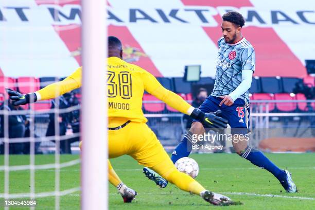 Yvon Mvogo of PSV and Devyne Rensch of Ajax during the Dutch Eredivisie match between PSV and Ajax at Philips Stadion on February 28, 2021 in...