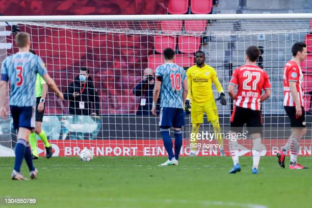 Yvon Mvogo of PSV and Dusan Tadic of Ajax during the Dutch Eredivisie match between PSV and Ajax at Philips Stadion on February 28, 2021 in...