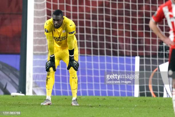 Yvon Mvogo of PSV disappointed during the UEFA Europa League match between PSV v Olympiakos Piraeus at the Philips Stadium on February 25, 2021 in...