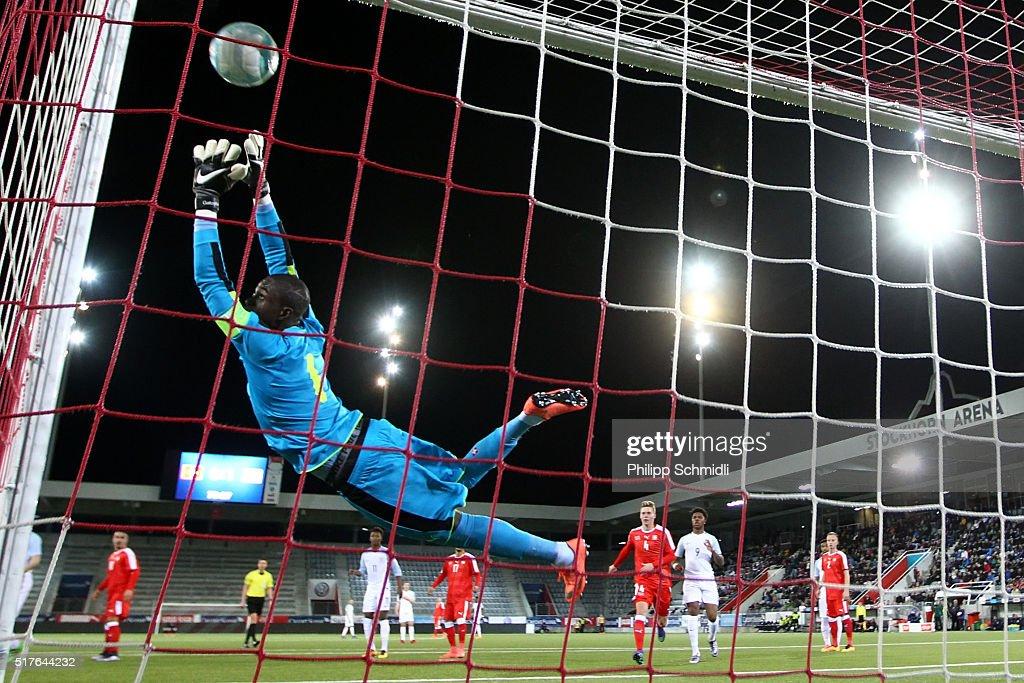 Yvon Mvogo of Switzerland U21 saves a freekick against James Ward-Prowse of England U21 (not pictured) during the European Under 21 Qualifier match between Switzerland U21 and England U21 at Stockhorn Arena on March 26, 2016 in Thun, Switzerland.