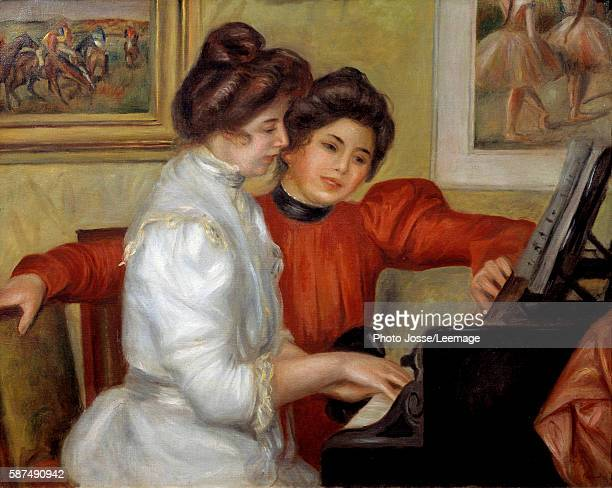 Yvonne and Christine Lerolle at the piano Painting by Pierre Auguste Renoir 1898 073 x 092 m Orangerie Museum Paris