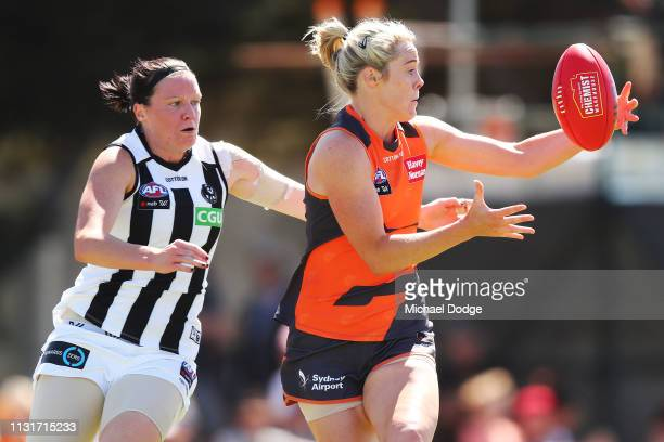Yvonne Bonner of GWS gathers the ball against Stacey Livingstone of the Magpies during the AFLW Rd 4 match between Collingwood and GWS at Morwekk...