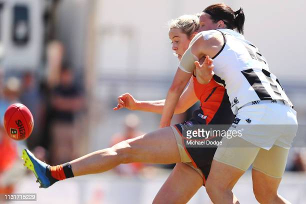 Yvonne Bonner of GWS kicks the ball for a goal against Stacey Livingstone of the Magpies during the AFLW Rd 4 match between Collingwood and GWS at...