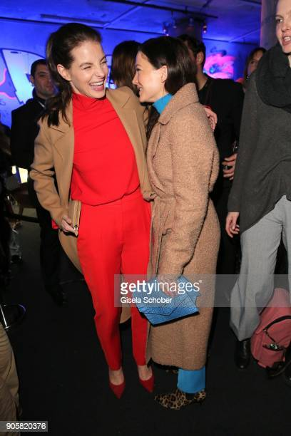 Yvonne Catterfeld and Hannah Herzsprung during the Marc Cain Fashion Show Berlin Autumn/Winter 2018 at metro station Potsdamer Platz at on January 16...