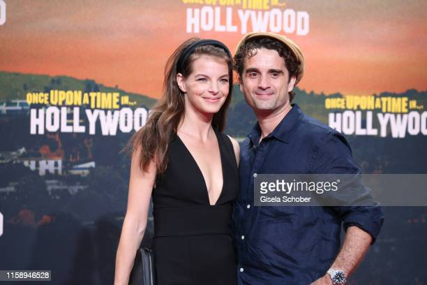 """Yvonne Catterfeld and her husband Oliver Wnuk during the premiere of """"Once Upon A Time... In Hollywood"""" at CineStar on August 1, 2019 in Berlin,..."""
