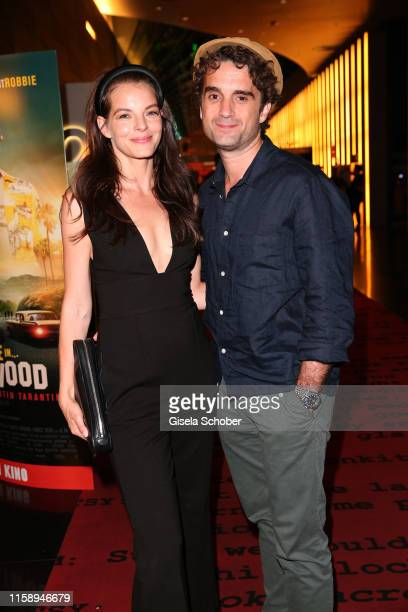 """Yvonne Catterfeld and her husband Oliver Wnuk during the premiere of """"Once Upon A Time... In Hollywood"""" leaving at CineStar on August 1, 2019 in..."""