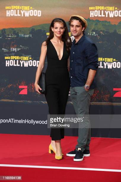 """Yvonne Catterfeld and Oliver Wnuk attend the premiere of """"Once Upon A Time... In Hollywood"""" at CineStar on August 01, 2019 in Berlin, Germany."""