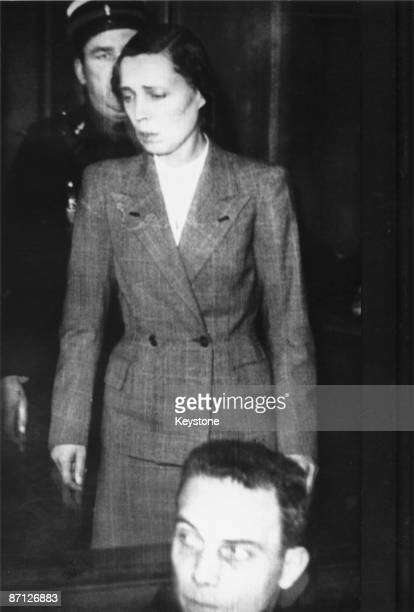 Yvonne Chevallier appears in the dock at the Reims Court of Assizes charged with the murder of her husband Pierre Chevallier Mayor of Orleans and a...