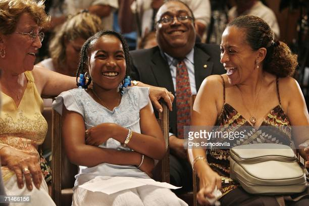 Yvonne Collins congratulates her granddaughter, Toni Bethea of Washington, DC, while her uncle Ron Collins and mother Rhonda Bethea look on after...