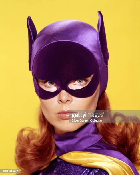 Yvonne Craig US actress in costume in a studio portrait against a yellow background issued as publicity for the US television series 'Batman' circa...