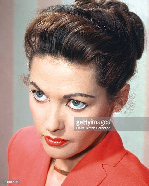 Yvonne De Carlo Canadian actress wearing a red jacket and a gold necklace circa 1955