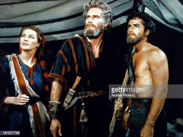 Yvonne De Carlo Charlton Heston and John Derek in a scene from the film 'The Ten Commandments' 1956