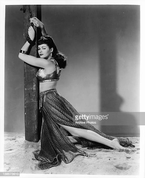 Yvonne De Carlo is chained to a column in a scene from the film 'Slave Girl' 1947