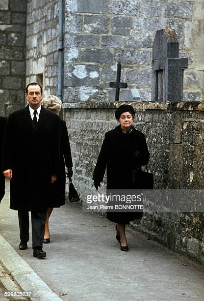 Yvonne De Gaulle And Son Philippe De Gaulle Walking Along The Cemetery Wall In ColombeyLesDeuxEglises on November 9 1970