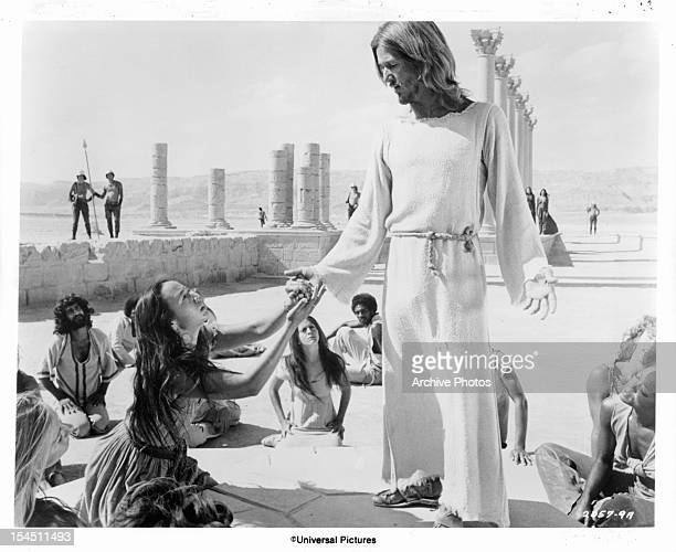 Yvonne Elliman is among the followers who kneel at the feet of Ted Neeley in a scene from the film 'Jesus Christ Superstar', 1973.