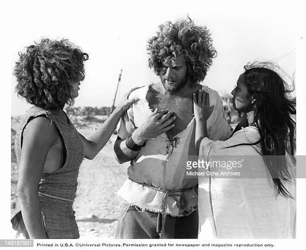 Yvonne Elliman puts her hand on an unknown actor's chest in a scene from the film 'Jesus Christ Superstar', 1973.