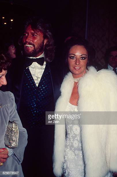 Yvonne Gibb with her husband Maurice Gibb She is wearing a white brocade and white fur circa 1970 New York
