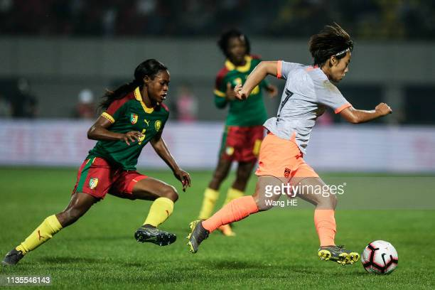 Yvonne Leuko Cameroon and Wang Shuang China in action during Wuhan International Women's Football Championship between China v Cameroon at Hankou...