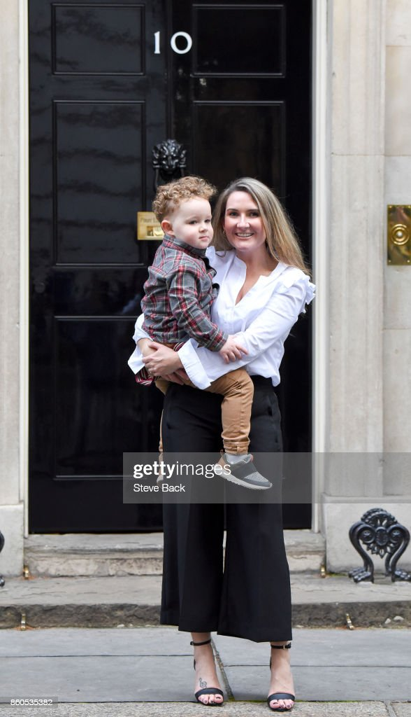 Yvonne MacHugh, fiance of Billy Irving, and her two year old son, William, deliver a petition to 10 Downing Street along other family members of the Chennai Six on October 12, 2017 in London, United Kingdom. The Chennai Six refers to the six British ex-soldiers who were jailed in India four years ago for firearms offences.