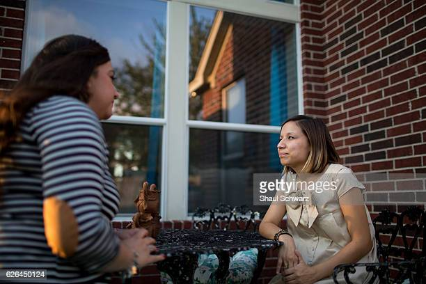 Yvonne Mendoza and her friend sit outside her home Yvonne is a first generation MexicanAmerican whose personal experiences with depression provide...
