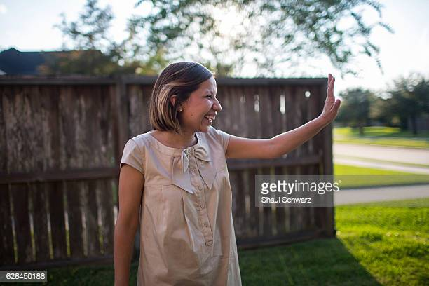 Yvonne Mendoza waves to her friend outside her house Yvonne is a first generation MexicanAmerican whose personal experiences with depression provide...