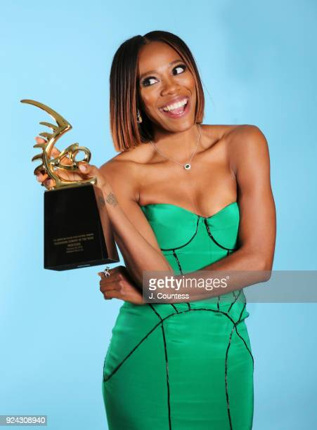 Yvonne Orji poses backstage with her award during the 2018 American Black Film Festival Honors Awards at The Beverly Hilton Hotel on February 25 2018...