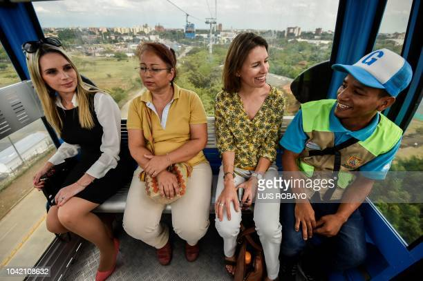 Yvonne Rieser Counselor of Austria and AnneSophie Houee Program Officer of the European Union speak with a local resident during a tour in the Siloe...