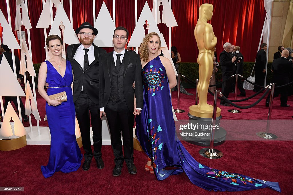 Yvonne Ross, Paul Young, Tomm Moore and Liselott Olofsson attend the 87th Annual Academy Awards at Hollywood & Highland Center on February 22, 2015 in Hollywood, California.