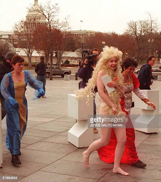 Yvonne Taylor Lady Godiva of People for the Ethical Treatment of Animals runs toward the US Department of Health and Human Services to deliver a...