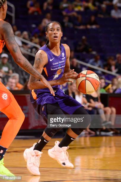 Yvonne Turner of the Phoenix Mercury handles the ball against the Connecticut Sun on August 14 2019 at Talking Stick Resort Arena in Phoenix Arizona...