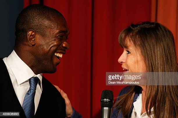 Yvonne van Gennip and Clarence Seedorf share a joke on stage as they speak to the students, media and guests during the Laureus European Workshop and...