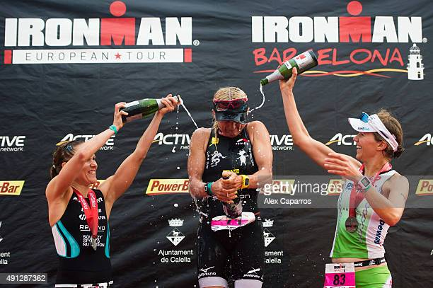 Yvonne Van Vlerken on 1st place Kaisa Lehtonen on 2nd place and Elisabeth Gruber on 3rd place celebrate their results after finishing Ironman...