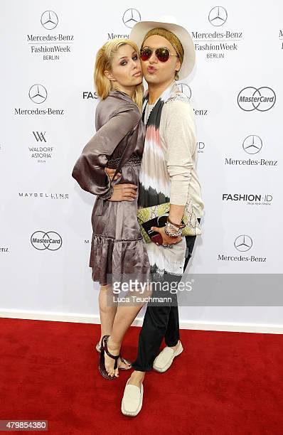 Yvonne Woelke and Julian F M Stoeckel attend the Anja Gockel show during the MercedesBenz Fashion Week Berlin Spring/Summer 2016 at Brandenburg Gate...