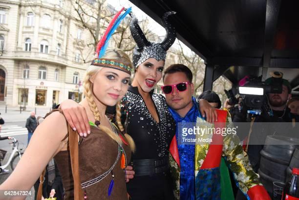 Yvonne Woelke, Micaela Schaefer and Rocco Stark attend the Berlin Carnival Parade on February 19, 2017 in Berlin, Germany.
