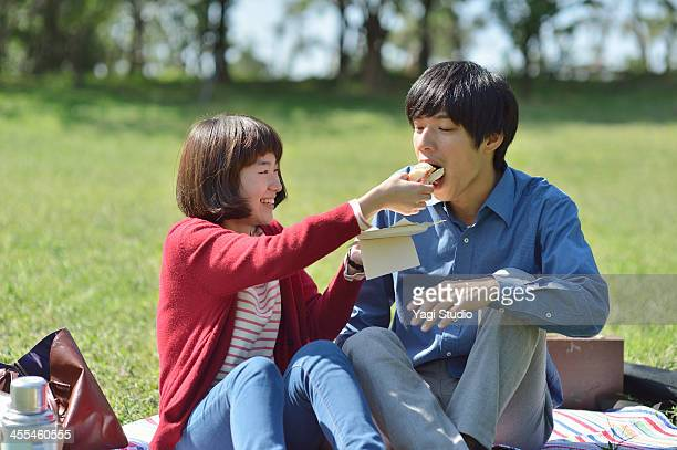 Yyoung couple having lunch at the picnic