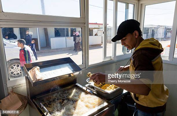Za'atari Mafraq Governorate Jordan February 5 2014 A teenager is working as a cook in the camp Zaatari is a refugee camp in Jordan located 10 km east...