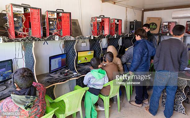 Za'atari Mafraq Governorate Jordan February 5 2014 Childs enjoy computer games in the cyber cafe of the camp Zaatari is a refugee camp in Jordan...