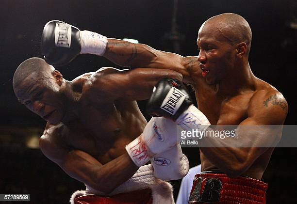 Zab Judah throws a right as Floyd Mayweather ducks under during the Welterweight Championship fight at Thomas Mack Arena on April 8 2006 in Las Vegas...